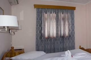 room 8 dimitris pension clean bedroom